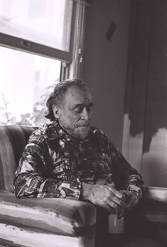 Joan Gannij Charles Bukowski sitting on his 'throne'- From 'the Man Behind the Myth series', 1976